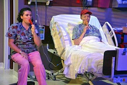WE WAKE ETERNALLY:  In a quiet moment of compassion, Vivian Bearing (Megan C.C. Walker)enjoys a Popsicle with her nurse Susie Monahan (Kerry DiMaggio), one of the only people at the hospital who treats her like a human and not just research. - PHOTO COURTESY OF JAMIE FOSTER PHOTOGRAPHY