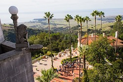 THE HEARST KINGDOM:  A balcony at Casa Grande overlooks the castle and a breathtaking view of San Simeon. - PHOTO BY JAYSON MELLOM