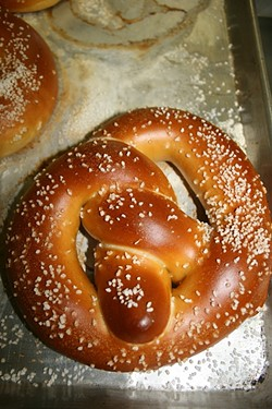 SALTY SNACK:  House of Bagels Central Coast crafts its pretzels the old fashioned way with plenty of flaky salt to spare. - PHOTO BY HAYLEY THOMAS