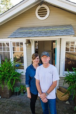 'NIGHTMARE':  Kathie and Steve Walker stand outside their home on Fredrick Street. The couple faces steep construction and permitting costs after an inspector found code violations. - PHOTO BY JAYSON MELLOM