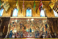ART FOR DAYS:  Silk flags representing different religious districts in Sienna and Flemish tapestries that are centuries old adorn the Refectory in Casa Grande. - PHOTO BY JAYSON MELLOM