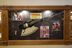 FEEL THE MUSIC:  A guitar once owned and signed by Gene Simmons of KISS hangs on the wall at Gary Kramer Guitar Cellars in Paso Robles. - PHOTO BY JAYSON MELLOM