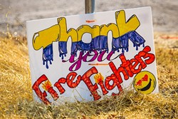 MANY THANKS:  The community shows its gratitude to firefighters working the Chimney Fire with a sign along Nacimiento Lake Road. - PHOTO BY JAYSON MELLOM
