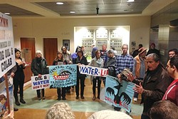 OIL AND WATER:  Northern Chumash Tribal Council spokesman Fred Collins rallies supporters of a Chumash Heritage Marine Sanctuary in the lobby of the SLO County government building prior to the Board of Supervisors' 3-2 vote passing a resolution in opposition of the sanctuary. - PHOTO BY PETER JOHNSON