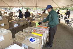 SUPPLIES:  Daniel Lockwood-Reif from the California Conservation Corps gathers supplies for firefighters from the supply depot at the Paso Robles Fairgrounds. - PHOTO BY JAYSON MELLOM