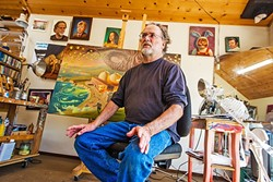 MAKING A STATEMENT :  Arroyo Grande artist Mark Bryan, above, talks about his art at his tree house studio in Arroyo Grande. Behind him sits Devil's Due, Meltdown at Diablo Canyon, depicting a natural disaster wreaking havoc at the local power plant. - PHOTO BY JAYSON MELLOM