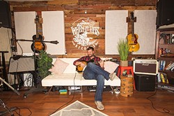 MAN CAVE DELUXE:  Moonshiner Collective frontman Dan Curcio kicks back in his plush South County home recording studio. - PHOTO BY JAYSON MELLOM