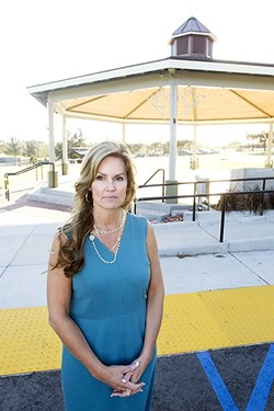 LEADING THE FIGHT:  SLO County Supervisor Lynn Compton stands in front of Nipomo Community Park's new gazebo/bandstand, which was built after a lawsuit against the park's master plan concluded in 2016. Compton is spearheading Nipomo's recent push to get back some of the public facility fees residents believe were unfairly allocated to other areas of the county. - PHOTO BY JAYSON MELLOM