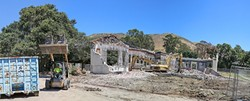 IN WITH THE NEW:  Just weeks before school starts in August, construction workers tear down San Luis Obispo High School's old annex building. In its place will be a new 12-classroom building. - PHOTO BY DYLAN HONEA-BAUMANN