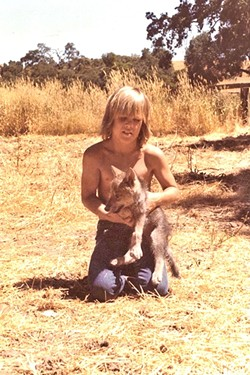 RANCH DAYS:  Young Josh Brolin on his Paso Robles-area family ranch with a canine. - PHOTO COURTESY OF JOSH BROLIN
