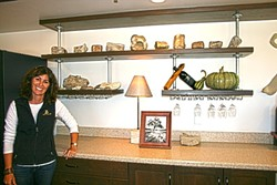OLDIE BUT A GOODIE:  Zenaida Cellars owner Jill Ogorsolka shows off shelves of ancient fossils lining her tasting room walls. - PHOTO BY HAYLEY THOMAS CAIN
