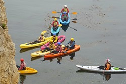 GUIDED TOUR:  A group of kayakers is given instruction about the dos and don'ts of entering the caves in the waters below the park. - PHOTO BY GLEN STARKEY