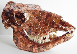 THE GLOW OF DEATH :  This cow's skull covered in shiny pennies by Silas Corley is designed to signify issues with mass consumerism and cheap beef leading to deforestation. - PHOTO COURTESY OF SILAS CORLEY