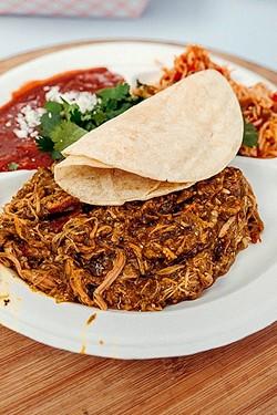 TACO THURSDAY:  Carnitas tacos are served up street side with cilantro, radish, onion, salsa roja, and local tortillas. - PHOTO COURTESY OF RICHARD FUSILLO
