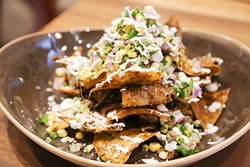 LIKE NO OTHER:  Nachos are elevated by rich duck meat and sharp, crumbly feta cheese. - PHOTO BY DYLAN HONEA-BAUMANN