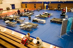 REFUGE :  The Red Cross set up a shelter for residents evacuated from the Chimney Fire at Flamson Middle School in Paso Robles. - PHOTO BY JAYSON MELLOM