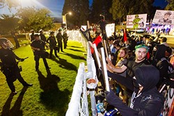 STAND OFF:  Protesters outside the Spanos Theater at Cal Poly demonstrate against right-wing activist Milo Yiannopoulos on Jan. 31, held off by a heavy law enforcement presence. - PHOTO BY JAYSON MELLOM
