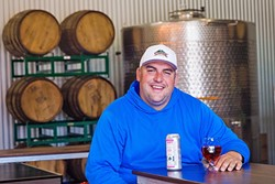 TIN MAN:  Andrew Jones, winemaker/owner at Field Recordings, has joined together with Mikey Giugni of Scar of the Sea and Curt Schalchlin, owner/vintner of Sans Liege, to create Tin City Cider Co. in Paso Robles. - PHOTO BY JAYSON MELLOM