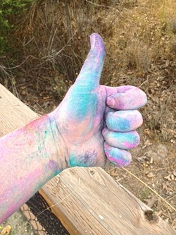 THUMBS UP:  Proceeds from the Run to Know More color run went to a good cause, the Santa Barbara North County Rape Crisis and Child Protection Center. - PHOTO BY CHRIS MCGUINNESS