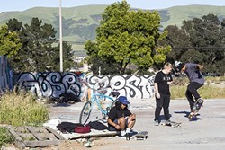 """THE SPOT:  Matt Diaz, Cody Barrackman, and Anthony Cruz have all skated in this abandoned lot in Nipomo since they were kids. """"We've been told we were going to get a skate park since I was 12,"""" said Diaz, who's 21 now. - PHOTO BY JAYSON MELLOM"""
