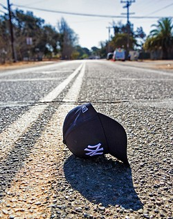 LABELS AND DATABASES :  Owning an off-color New York Yankees hat and living in Nipomo could cause investigators with the San Luis Obispo County Sherriff's Office to believe you're a gang member. - PHOTO BY JAYSON MELLOM