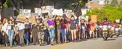 "IN THE STREETS:  Chants of ""Love Trump's Hate!"" and ""This is what democracy looks like!"" filled the air as protestors marched on downtown SLO Nov. 12. - PHOTO BY JAYSON MELLOM"