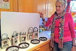 """NOT MY CUP OF TEA:  Australian Artist Jan Dungan shows off her """"despots"""" at her home in Arroyo Grande. Each ceramic teapot features a depiction of figures like Donald Trump, Fidel Castro, and Adolph Hitler. - PHOTO BY RYAH COOLEY"""