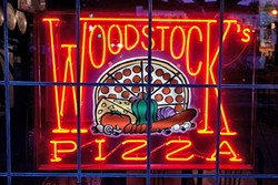 "PITCHER AND A BEER :  Woodstock's in SLO will soon be home to a new seating and event area decked out to look like the ""coolest backyard you've ever stepped foot in,"" according to co-owner Laura Abrose. - PHOTO COURTESY OF WOODSTOCKS PIZZA"