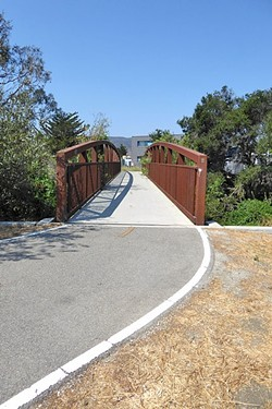ENTER HERE!:  This pedestrian and bike bridge on the corner of Prado Road leads to the newest segment of the Bob Jones Trail that will eventually connect to Avila Beach. - PHOTO BY GLEN STARKEY