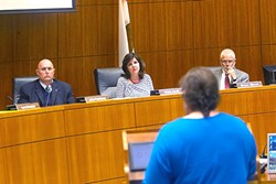 SCOLDED:  Los Osos resident Violet Cavanaugh (foreground) criticizes San Luis Obispo County Supervisors John Peschong, Debbie Arnold, and Bruce Gibson (left to right) on March 21 for making a groundwater policy decision on March 7 without public comment. - PHOTO BY JAYSON MELLOM