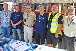 WORLD RECORD HOLDER! :  SLO resident Bernd Schumacher (fourth from left) secured the world record for the largest Z-gauge model train collection on Sept. 17 at Beda's Biergarten. Proprietor Beda Schmidthues stands to his right. - PHOTO BY GLEN STARKEY