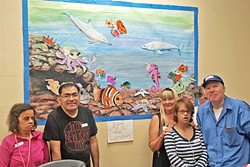 TIME FOR ART:  Lyndon Schaeffer's students stand in front of a whimsical seascape they worked on together. - PHOTO COURTESY OF LYNDON SCHAEFFER
