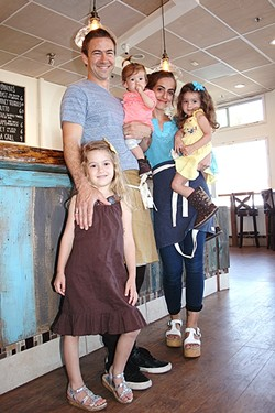 BUSY BEES:  Red Bee Coffee owners Crosby and Miria Moreton stop for a coffee break with daughters Eliya, 5; Levia, 3; and Talya, 1. - PHOTO BY HAYLEY THOMAS CAIN