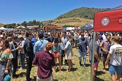 GET IN LINE:  The crowds were so thick you needed to get a beer and go directly to another line to keep your glass filled. - PHOTO BY GLEN STARKEY