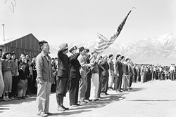 MANZANAR:  Memorial Day services in 1942 at Manzanar, Calif., an interment camp where people of Japanese descent were sent during World War II. - PHOTO COURTESY OF THE NATIONAL ARCHIVES AND RECORDS ADMINISTRATION