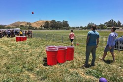 BROS WILL BE BROS:   The 2017 California Beer Festival, held May 27 in the Madonna Inn meadow, brought out a huge crowd of college kids, some of whom played giant beer pong. - PHOTO BY GLEN STARKEY