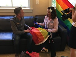 VANDALIZED:  SLO Mayor Heidi Harmon talks with Ryan Duclos, president of SLO County's Gay and Lesbian Alliance, after an unknown vandal set fire to a pride flag outside her home May 31. - PHOTO COURTESY OF ELLEN STURTZ