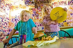 BURGER TOWN:  Bodie Read, 5, and his sister Lila Read, 2, enjoy a kids meal at Sylvester's Burgers, the best place to take your child to for a burger and fries (and there's beer for you, too!). - PHOTO BY JAYSON MELLOM