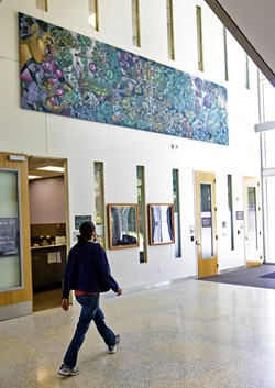 OUT AND ABOUT The Integrated Visionaries mural at Cal Poly's Warren J. Baker Center for Science and Mathematics was inspired by themes of diversity, inclusivity, and community. - PHOTO BY JAYSON MELLOM