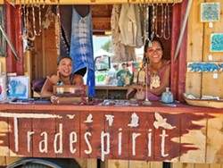 SPIRIT QUEENS Tradespirit Mobile Boutique proprietor Jen Chen (left) and her friend and co-worker Azere Wilson helm their adorable vendor trailer, vowing to return to Live Oak next year. - PHOTO BY GLEN STARKEY