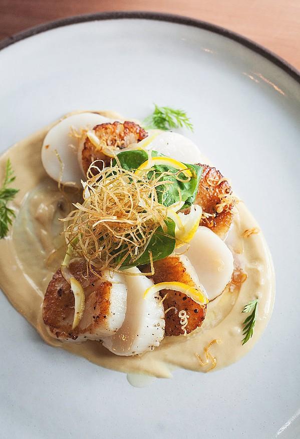 SEA SENSATION Blue Heron's pan seared scallops come with with lemon beurre blanc, crispy leeks, and preserved lemon. - PHOTOS COURTESY OF BLUE HERON