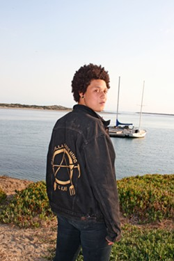 """GARDEN, ANARCHY, PEACE Anna Benjamin of Morro Bay joined the Guerrilla Gardening Club in 2015. She wears a jacket she emblazoned with the nonprofit's edgy logo, which stands for """"garden, anarchy, peace."""" - PHOTO BY HAYLEY THOMAS CAIN"""