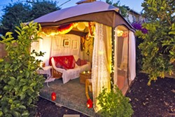 BEAUTY ON A BUDGET Sarah and Evan Goldhahn's SLO Town rental features a 10-by-12-foot deck Evan built with a friend, a store-bought gazebo, and décor by Sarah sourced from Craigslist, consignment stores, and collecting. - PHOTO BY JAYSON MELLOM