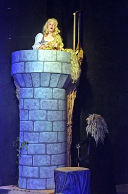 THE GOLDEN STAIRS All alone in her tower, with no company save for visits from her weird mother the witch, is Rapunzel (Olivia Edmonds) with hair as gold as corn. - PHOTO COURTESY OF JAMIE FOSTER PHOTOGRAPHY