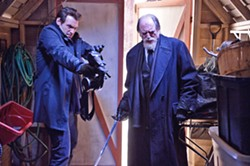 """TAKE THAT, BLOODSUCKER! Armed with a silver-spike-shooting nail gun, CDC Dr. Ephraim """"Eph"""" Goodweather (Corey Stoll, left) and sword-wielding vampire hunter Professor Abraham Setrakian (David Bradley) set about trying to end an outbreak of vampirism in NYC. - PHOTO COURTESY OF FX"""