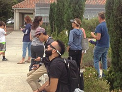 TOTAL ECLIPSE An overcast sky didn't stop people at Cuesta College in SLO from trying to view the total solar eclipse at the school's Bowen Observatory. - PHOTO BY CHRIS MCGUINNESS