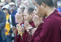 INTERNATIONAL SUPPORT Tibetan monks from the Drepung Loseling Monastery made a special appearance at the vigil for Heather Heyer and other victims of white nationalist and white supremacist violence in Charlottesville. - PHOTO BY JAYSON MELLOM