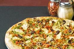 NUCCI'S PIZZA Delights like this vegetarian pesto pizza await at Nucci's Pizza. - PHOTO COURTESY OF NUCCI'S PIZZA