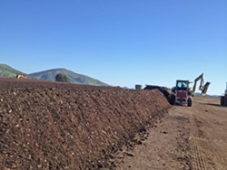LOCALLY MADE Cal Poly compost is made by students—by the campus, for the campus. It's sold locally and supplies campus landscaping services and the organic farm. - PHOTO COURTESY OF CAL POLY AG OPERATIONS DEPARTMENT
