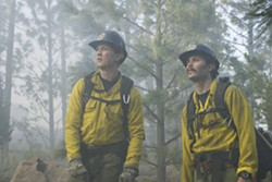 BROTHERHOOD Though at first at odds with one another, new crewmember Brendan McDonough (Miles Teller, left) bonds with veteran Christopher MacKenzie (Taylor Kitsch, right), in the wildfire drama Only the Brave. - PHOTOS COURTESY OF BLACK LABEL MEDIA
